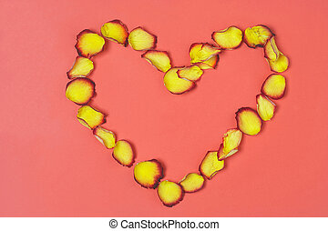 Heart - Herz - Heart made of yellow-red rose petals on red...