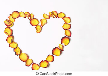 Heart - Herz - Heart made of yellow-red rose petals on white...