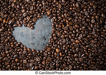 Heart in coffee beans on metal background