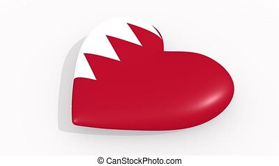 Heart in colors and symbols of Bahrain on white background,...