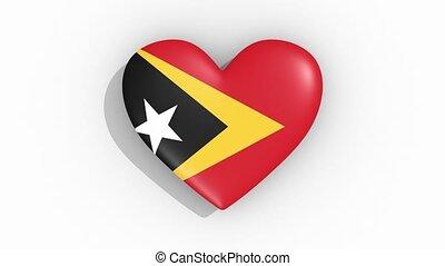 Heart in colors flag of East Timor pulses, loop.