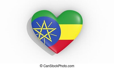 Heart in colors flag of Ethiopia pulses, loop
