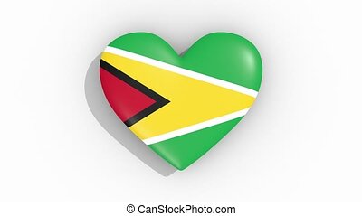 Heart in colors flag of Guyana pulses, loop - Heart in...