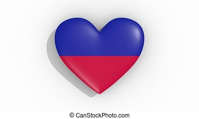 Heart in colors flag of Haiti pulses, loop