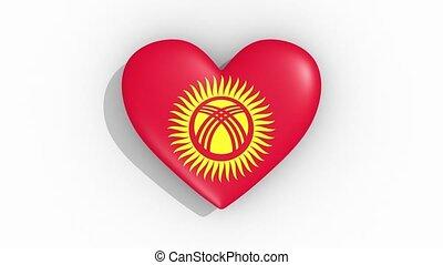 Heart in colors flag of Kyrgyzstan pulses, loop.