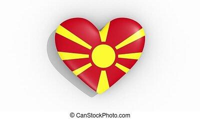 Heart in colors flag of Macedonia pulses, loop