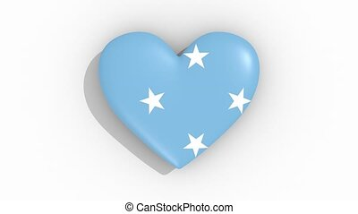 Heart in colors flag of Micronesia pulses, loop - Heart in...