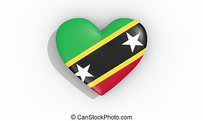 Heart in colors flag of Saint Kitts and Nevis pulses, loop....