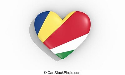 Heart in colors flag of Seychelles pulses, loop.