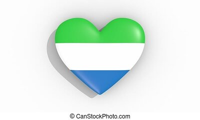 Heart in colors flag of Sierra Leone pulses, loop