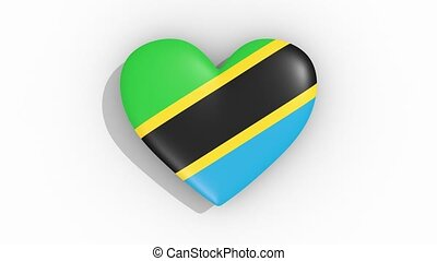 Heart in colors flag of Tanzania pulses, loop.