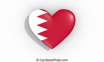 Heart in colors of flag of Bahrain pulses, loop