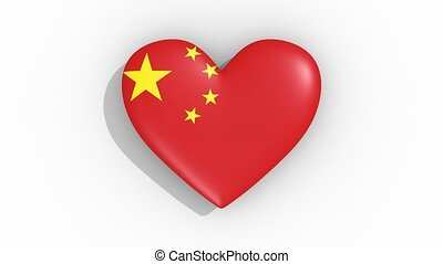 Heart in colors of flag of China pulses, loop.