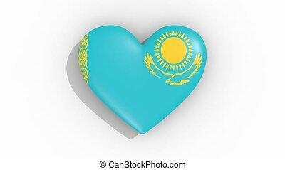 Heart in colors of flag of Kazakhstan pulses, loop.