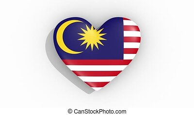Heart in colors of flag of Malaysia pulses, loop.