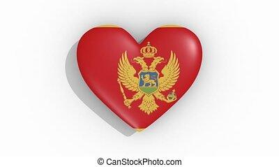 Heart in colors of flag of Montenegro pulses, loop
