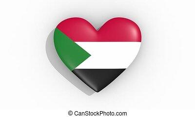 Heart in colors of flag of Sudan pulses, loop.