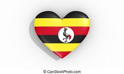 Heart in colors of flag of Uganda pulses, loop.