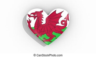 Heart in colors of flag of Wales pulses, loop