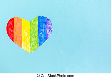 Heart in lgbtq colors on blue background, top view