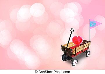 Heart in little red wood wagon.