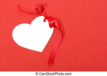 Heart in red background with bow