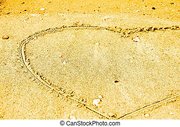 heart in sand at the beach