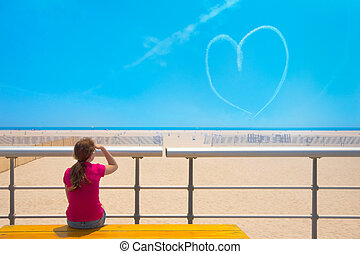 Heart in sky and girl