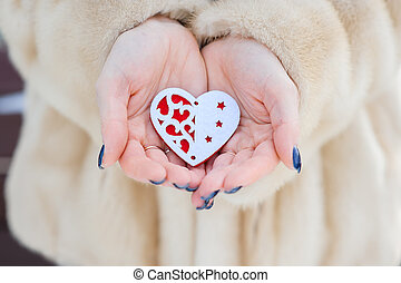 heart in the hands of a girl