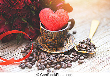 Heart in wooden coffee cup with coffee beans romantic love valentines day and red rose flower on wood background - love coffee concept
