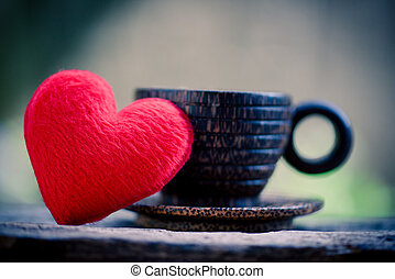 Heart in wooden coffee cup with romantic love valentines day on wood background - love coffee concept