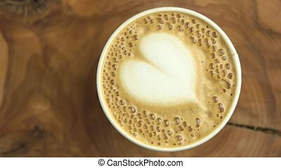 Heart latte art top view. Coffee with bubbles.