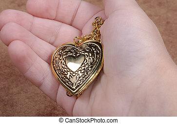 Heart Locket in a Hand