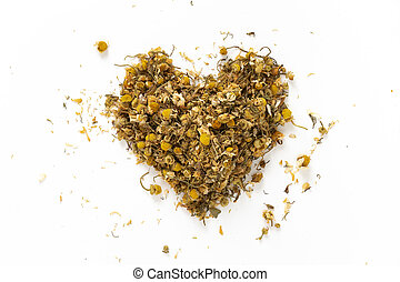 Heart made of dried chamomile tea, on white background.