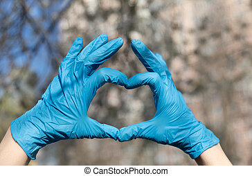 Heart made of latex, nitrile medical gloves