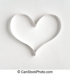 Heart made of paper on white background
