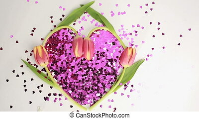 Heart made of pink confetti framed