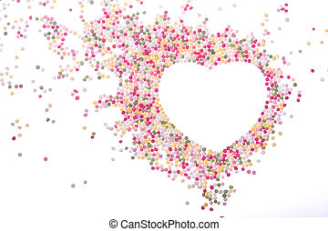 Heart shaped frame made from colored sprinkles