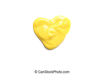 Heart made of yellow sauce isolated on white background