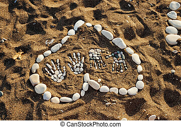 heart made with pebbles on the beach