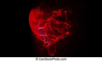 heart manifests of particles on a black background, alpha-channel video loop