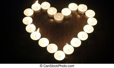 Heart of candles. Candles arranged in a heart shape