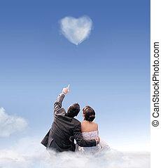 Heart of cloud - studio shot of a wedding couple