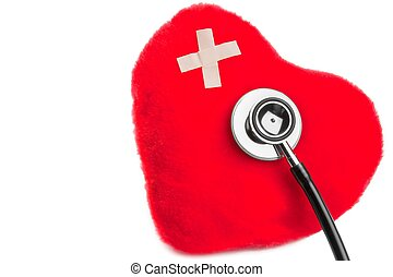 heart of cuddly toys with patch near stethoscope