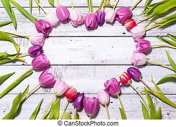 Heart of fresh tulips
