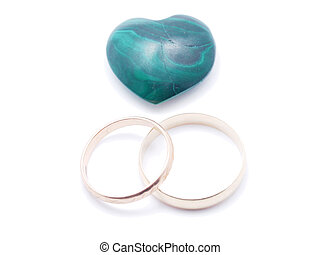 heart of malachite and wedding rings on a white background