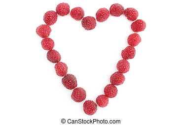 Heart of raspberries on white background