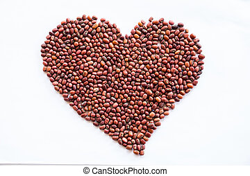 Heart of red beans on a white background