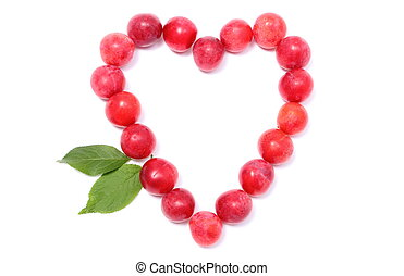 Heart of red mirabelle on white background