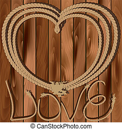 Heart of rope on a wooden background